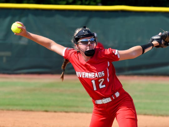 Teammates join Riverheads' pitcher Emily Walters delivers