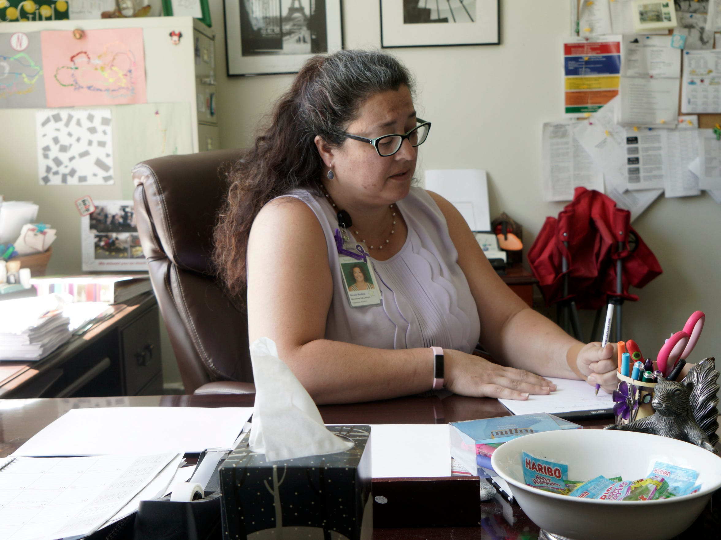 Nicole Medina sees a lot of cases of elder abuse in her role as as family services supervisor for Adult Protective Services with the Shenandoah Valley Department of Social Services. She is photographed in her office in Waynesboro on June 5, 2018. Medina also serves as vice president for the Greater Augusta Coalition Against Adult Abuse.