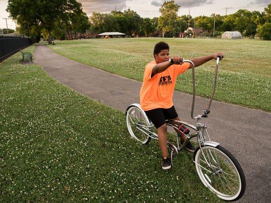 Dezmond Robertson, 14, tries out a bike at Edgehill