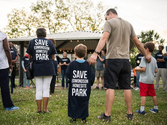 Community members gather for a vigil at Edgehill Memorial Gardens Park in reaction to the possible sale of the park in Nashville, Tenn., Wednesday, June 13, 2018.