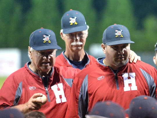 Harrisonburg Turks' head coach Bob Wease, left, presents