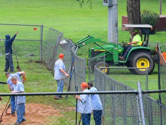 Inmates with Middle River Regional Jail work to cleanup