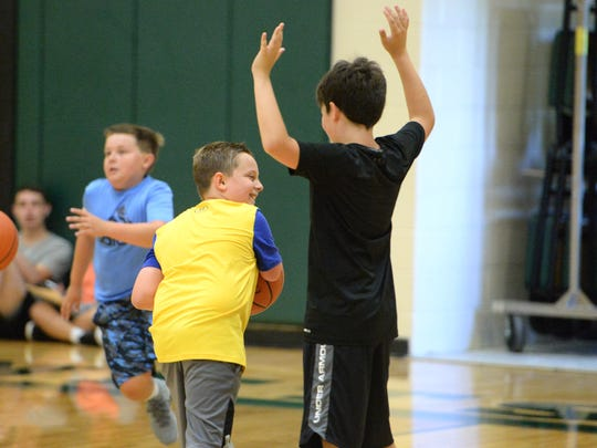 Beckett Ryder (yellow shirt) was born missing most of his right arm, but the 9-year-old Waynesboro boy hasn't let it stop him from playing basketball and baseball.