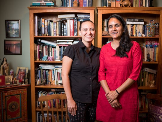 Indie Pereira, left, and her wife Pari Bhatt, right, at their home in Nashville, Thursday, June 28, 2018. The couple attends St. Philip's Episcopal Church, but opted for a civil ceremony because their bishop will not permit clergy within their diocese to marry same-sex couples.