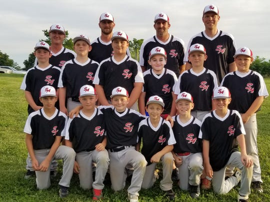 South Augusta 10U won its first game Wednesday in the Cal Ripken Southeast Region Tournament in Jacksonville, Florida. Front row, from left: Brody Phillips, Logan Austin, Dalton Coffey, Tyler Wade, Ashton Kessler, Brady Majors; Second row: Holden Fitzgerald. Ryan Shover, Price Lunsford, Dean Fafatas, Levi Dunlap, Henley Dunlap; third row: Coach Joey Wade, Coach Chad Coffey, Head Coach Greg Phillips, and Coach Josh Dunlap.