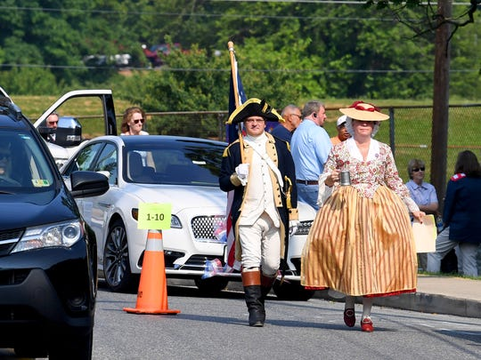 City councilman Erik Curren arrives with wife Lindsay Curren to participate in the Happy Birthday America Parade at Gypsy Hill Park in Staunton on Wednesday, July 4, 2018.