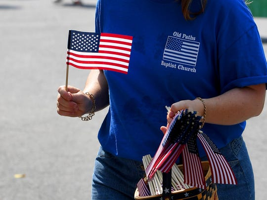 Flags to be handed out to spectators along the route. The Happy Birthday America Parade made its way through Gypsy Hill Park in Staunton on Wednesday, July 4, 2018.