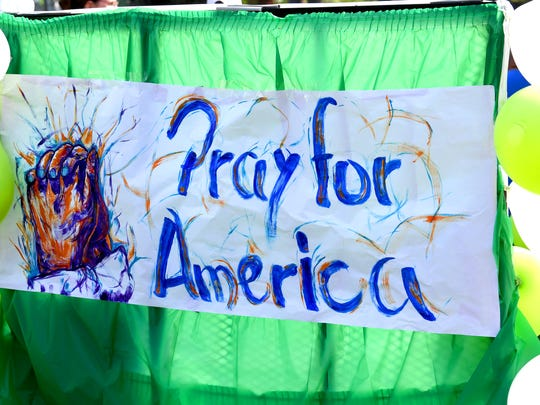 """""""Pray for America"""" is displayed on one float. The Happy Birthday America Parade made its way through Gypsy Hill Park in Staunton on Wednesday, July 4, 2018."""