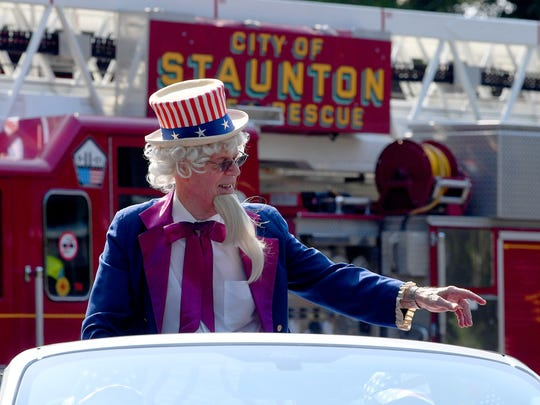 Uncle Sam, portrayed by R.M. Stone, waves and points to the spectators in the crowd. The Happy Birthday America Parade made its way through Gypsy Hill Park in Staunton on Wednesday, July 4, 2018.