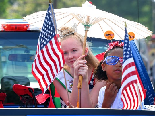 Junior Miss Augusta County Fair Hailey Mahaffey, 13, waits with Kalionna Bosserman, 10, on the float before the start of the Happy Birthday America Parade at Gypsy Hill Park in Staunton on Wednesday, July 4, 2018.