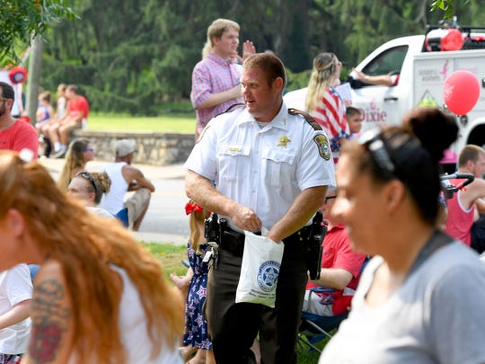 Augusta County Sheriff Donald Smith walked among the spectators to make sure he handed candy out to all the children wishing some while he walked the parade route. The Happy Birthday America Parade made its way through Gypsy Hill Park in Staunton on Wednesday, July 4, 2018.
