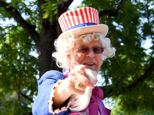 Uncle Sam, portrayed by R.M. Stone, waves and points