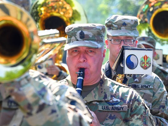The 29th Army Band performs for the crowd as the follow