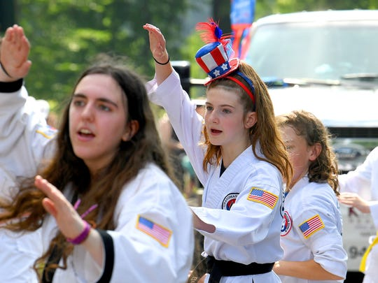 Members of Grandmaster DongÕs Martial Arts School demonstrate their skills for the crowd.  The Happy Birthday America Parade made its way through Gypsy Hill Park in Staunton on Wednesday, July 4, 2018.