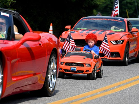One young parade participant shows that not all Mustangs have to be full sized cars to be drive in the parade.  He drives among a variety of other larger Ford Mustangs. The Happy Birthday America Parade made its way through Gypsy Hill Park in Staunton on Wednesday, July 4, 2018.