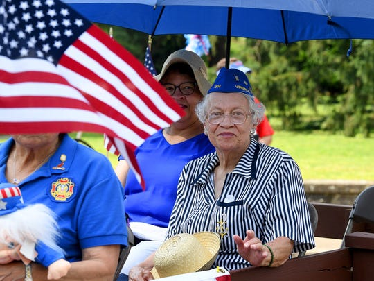 Members of the ladies auxiliary for VFW Post 7814 wave