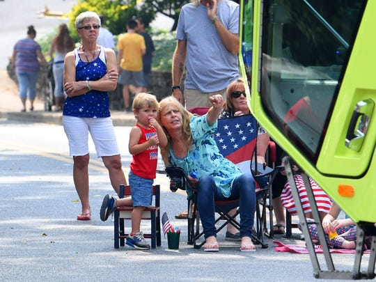 One young spectator looks to the camera as the person he is with points out one of several fire trucks in the parade. The Happy Birthday America Parade made its way through Gypsy Hill Park in Staunton on Wednesday, July 4, 2018.
