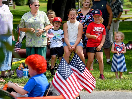 Spectators watch the parade pass by from their vantage point along the route. The Happy Birthday America Parade made its way through Gypsy Hill Park in Staunton on Wednesday, July 4, 2018.