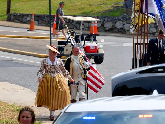 City councilman Erik Curren still carries his 1776 flag as he exits Gypsy Hill Park after walking the entire distance of the route for the Happy Birthday America Parade in Staunton on Wednesday, July 4, 2018.