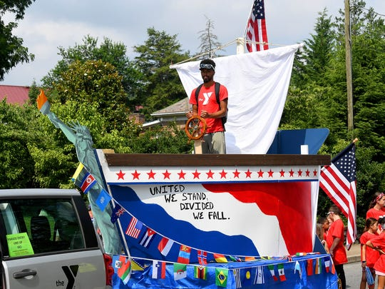 """The YMCA's float is a ship with the words """"United We Stand. Divided We Fall"""" written along the side. The Happy Birthday America Parade made its way through Gypsy Hill Park in Staunton on Wednesday, July 4, 2018."""