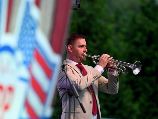 Ben Fairfield uses his trumpet to perform the national