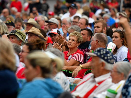 Those gathered applaud during a rendition of America the Beautiful being performed on stage at John Moxie Stadium as the feature performance at Happy Birthday America in Staunton on Wednesday, July 4, 2018.