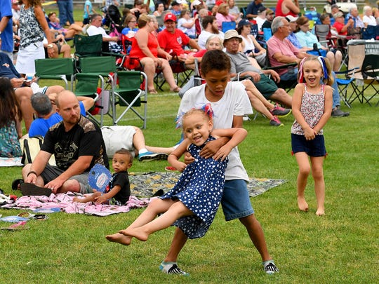 Children have fun playing together while attending the concerts taking place at John Moxie Stadium as part of Happy Birthday America in Staunton on Wednesday, July 4, 2018.