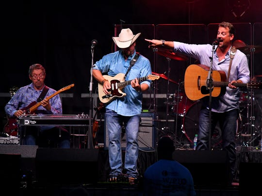 Wil and Langdon Reid of Wilson Fairchild performs live on stage for the crowd gathered at John Moxie Stadium as the feature performance at Happy Birthday America in Staunton on Wednesday, July 4, 2018.