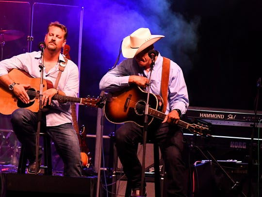 Bryan Kennedy (right) performs on stage next to Langdon