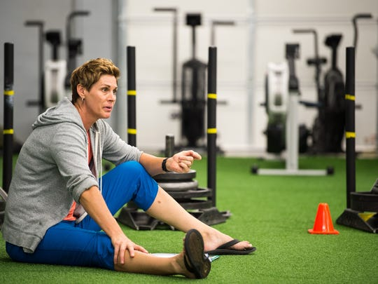 Tash Weddle speaks during a fitness class at the New