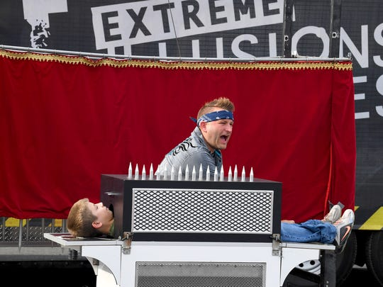 Performer Josh Knotts of Extreme Illusions and Escapes