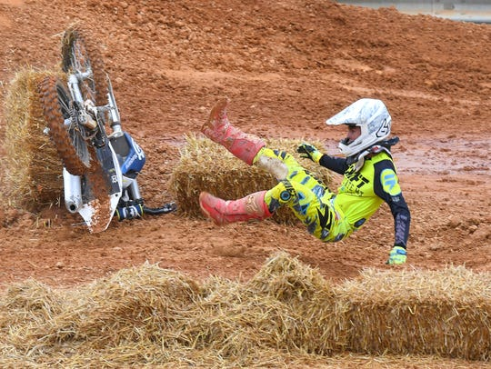 A rider comes free of his dirt bike while competing