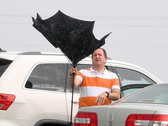 As soon as he opens it, the wind catches a fairgoers umbrella and turns it the wrong way after arriving at the Augusta County Fair on Wednesday, August 1, 2018.