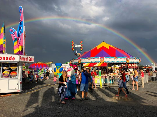 A rainbow paints the sky over the midway at the Augusta County Fair on Wednesday, August 1, 2018.