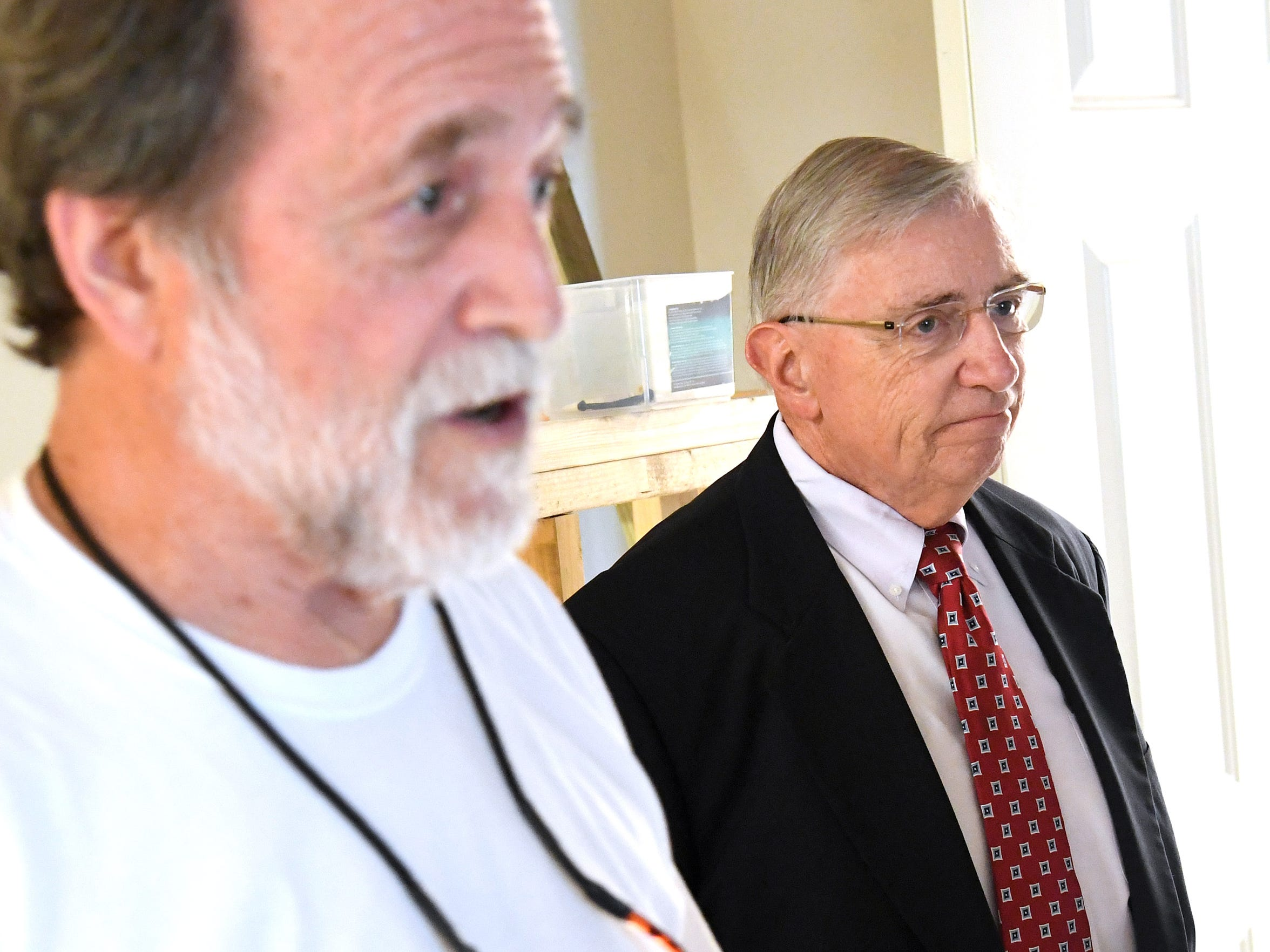 David Deering (right), executive director of Valley Community Services Board, listens as Clark Banta (left), executive director of Valley Supportive Housing, talks about the new apartments being added to Johnson Street Apartments during an interview in Staunton on Friday, August 3, 2018.