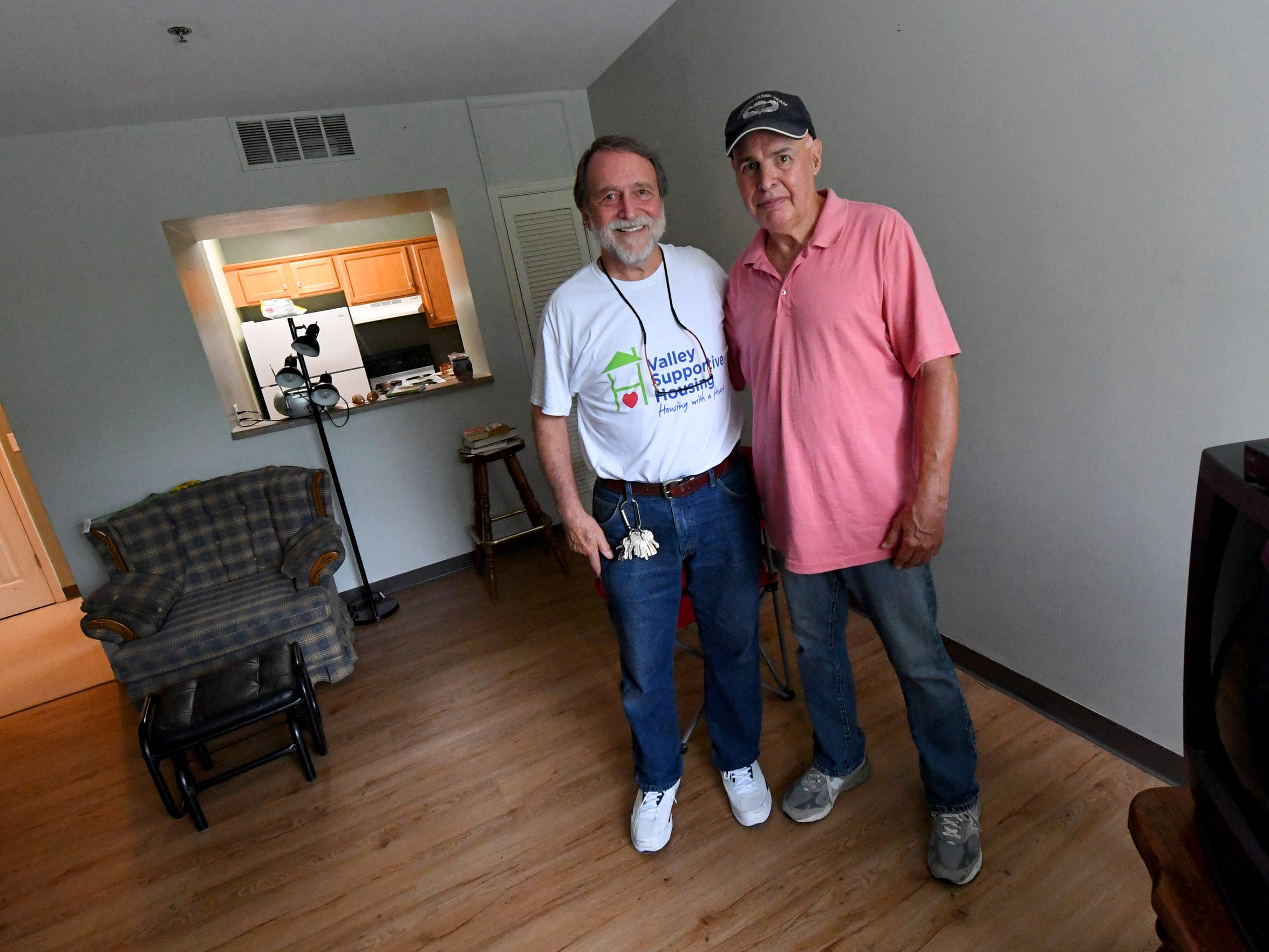 Clark Banta, executive director of Valley Supportive Housing, stands with Jan Craun, a resident already living at the Johnson Street Apartments. They are photographed within Craun's home on Friday, August 3, 2018.
