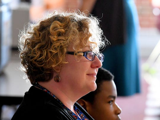 New sixth grade teacher Lea Thorne listens while sitting