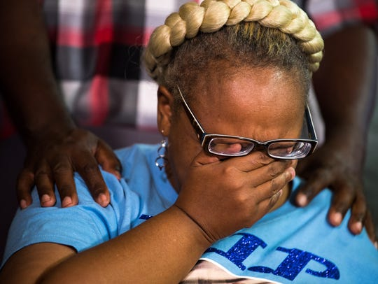 Vickie Hambrick, mother of Daniel Hambrick, wipes away tears during a press conference addressing the release of a video showing the police shooting of her son.