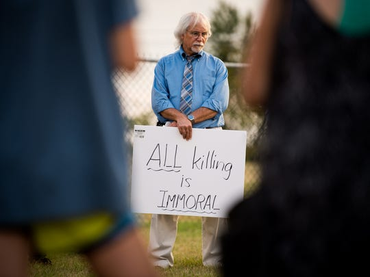 Jon Warkentin of Nashville gathers with protesters outside of the Riverbend Maximum Security Institution against the execution of Billy Ray Irick in Nashville, Tenn., Thursday, Aug. 9, 2018. Irick, 59, was convicted in 1986 on charges of raping and murdering Paula Dyer, a 7-year-old Knox County girl.