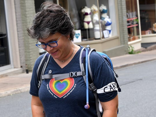 "Wendy Stanley with ""Cares"" walks along the Downtown"