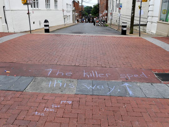 """The killer sped this way"" is written on 4th street"