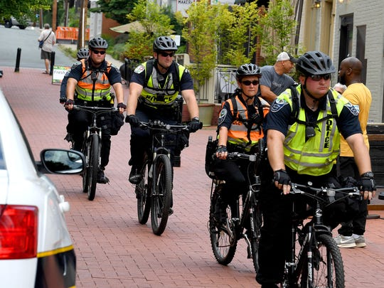 Police officers from different localities ride bikes