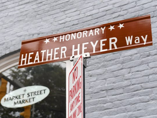 A sign marks a stretch of 4th Street as Honorary Heather