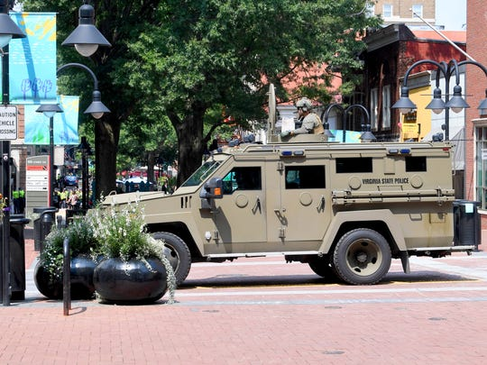An armored vehicle with the Virginia State Police holds position on the Downtown Mall as protesters confront law enforcement just outside the secured perimeter surrounding the mall in Charlottesville, Va., on Sunday, August 12, 2018. The day marked the anniversary of the deadly protests last year.