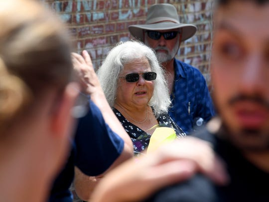 Susan Bro, mother of Heather Heyer, visits the site her daughter was killed the year before near the time of the deadly car attack on 4th Street in Charlottesville, Va., on Sunday, August 12, 2018. The day marked the anniversary of the deadly protests last year.