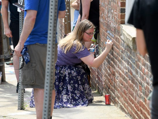 A person visiting 4th Street where Heather Heyer was