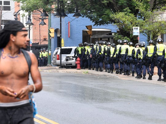 Virginia State Police officers withdrawal as the barricades