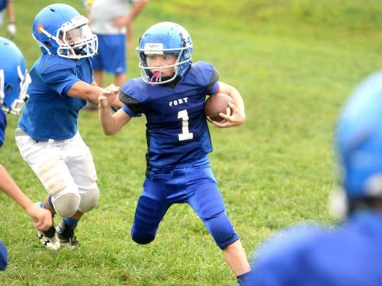 Fort Defiance junior football player Bradley Hebb gets