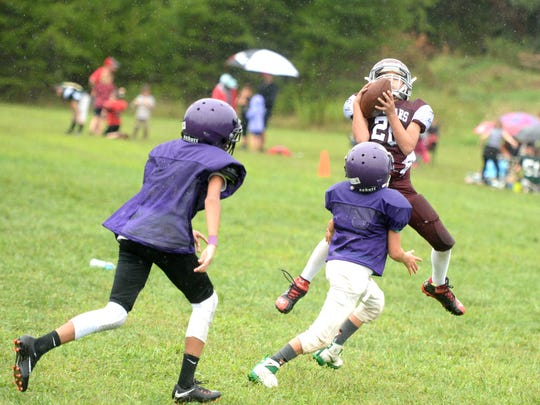 A Stuarts Draft junior football player hauls in a pass
