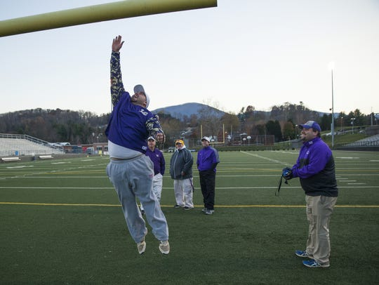 Waynesboro assistant football coach Aaron Lamb leaps